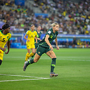 GRENOBLE, FRANCE June 18.  Alanna Kennedy #14 of Australia defends by Konya Plummer #5 of Jamaica during the Jamaica V Australia, Group C match at the FIFA Women's World Cup at Stade des Alpes on June 18th 2019 in Grenoble, France. (Photo by Tim Clayton/Corbis via Getty Images)