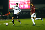 Curtis Davies and Vadaine Oliver compete for the ball during the The FA Cup match between Northampton Town and Derby County at the PTS Academy Stadium, Northampton, England on 24 January 2020.
