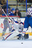 PENTICTON, CANADA - SEPTEMBER 16: Nick Ellis #34 of Edmonton Oilers makes a save against the Vancouver Canucks on September 16, 2016 at the South Okanagan Event Centre in Penticton, British Columbia, Canada.  (Photo by Marissa Baecker/Shoot the Breeze)  *** Local Caption *** Nick Ellis;
