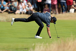 England's Eddie Pepperell picks his ball out of the hole during day four of The Open Championship 2018 at Carnoustie Golf Links, Angus.
