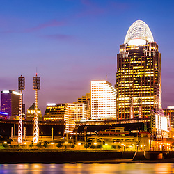 Cincinnati skyline at night panorama photo of Cincinnati riverfront and downtown city office buildings. Panorama photo ratio is 1:3.