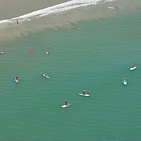 An aerial view of stand up paddle boarders during the 28th annual National Kidney Foundation, Rich Salick Pro/Am surf festival takes place at the the Cocoa Beach pier on Saturday,  September 2, 2013 in Cocoa Beach, Florida. This event raises thousands of dollars for people with kidney disease and also benefits the services of the NKF of Florida. (AP Photo/Alex Menendez)