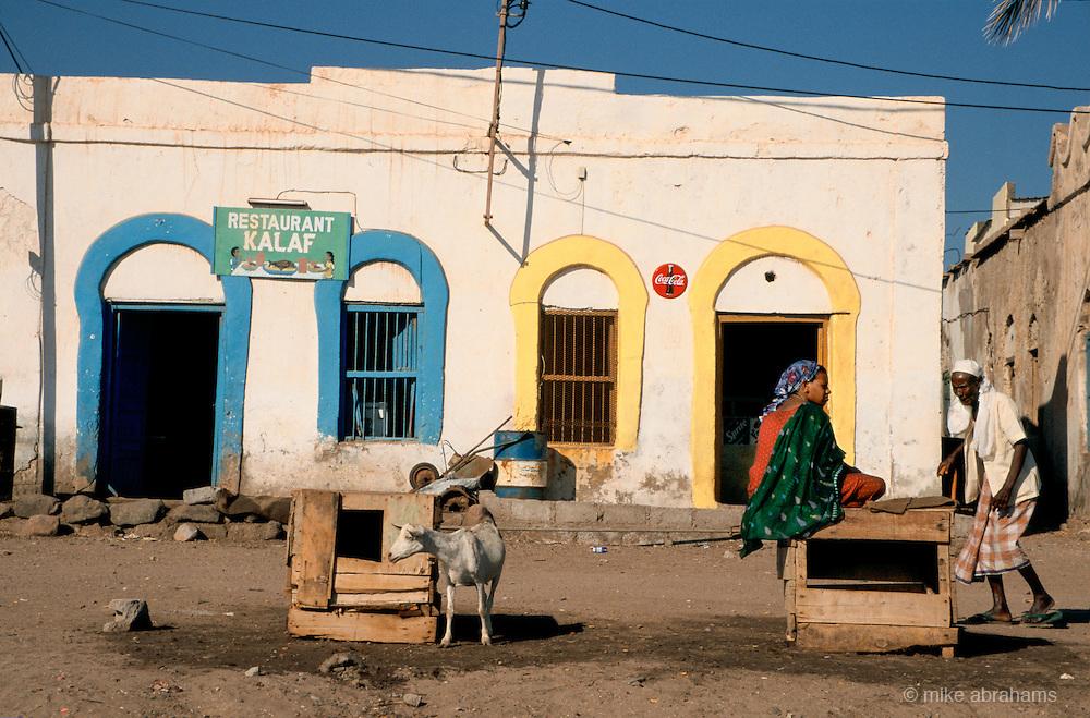 A goat walks in the street outside a restaurant in  Tadjoura, Republic of Djibouti