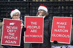 London, UK. 20 December, 2019. Brexit supporters holding placards gather outside Parliament as the Brexit Withdrawal Agreement Bill is resubmitted for debate and a vote inside the House of Commons.