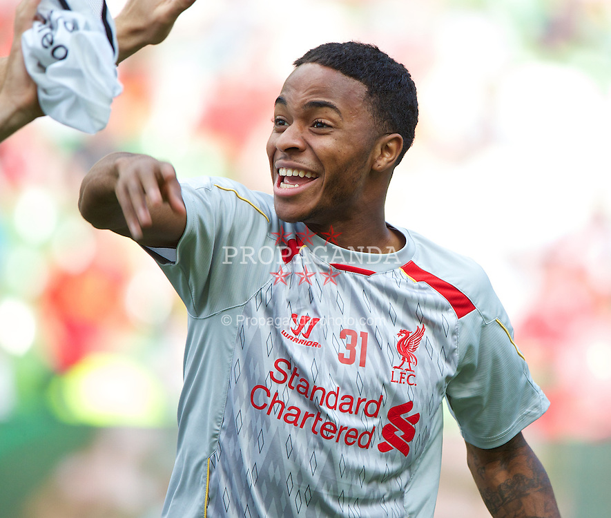 DUBLIN, REPUBLIC OF IRELAND - Saturday, August 10, 2013: Liverpool's Raheem Sterling warms-up before a preseason friendly match against Glasgow Celtic at the Aviva Stadium. (Pic by David Rawcliffe/Propaganda)