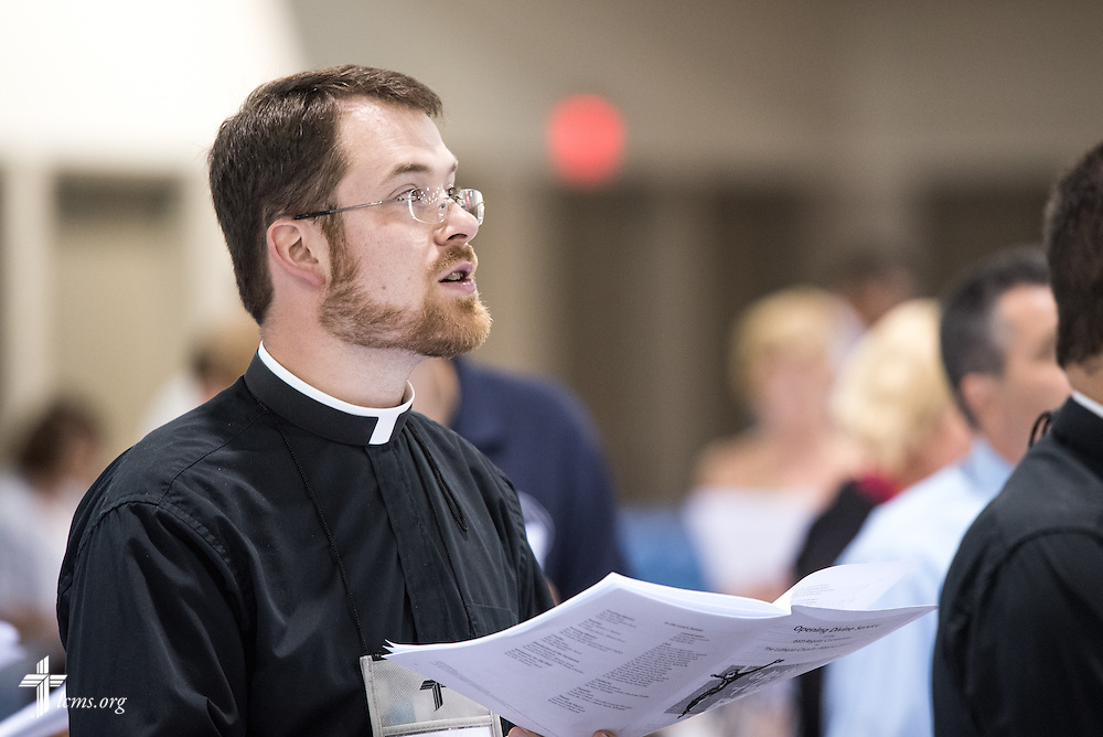 A pastor worships during the Opening Divine Service of the 66th Regular Convention of The Lutheran Church–Missouri Synod on Saturday, July 9, 2016, at the Wisconsin Center in Milwaukee. LCMS/Frank Kohn