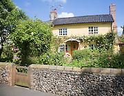 Pretty cottage garden with roses Mendlesham, Suffolk, England