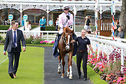ROYAL INTERVENTION (15) ridden by Paul Hanagan and trained by Ed Walker enter the Winners Enclosure after winning The Group 3 William Hill Summer Stakes over 6f (£65,000)   during the John Smiths Cup Meeting at York Racecourse, York, United Kingdom on 12 July 2019.