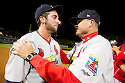 Greg Garcia (7) and Manager Mike Shildt (8) of the Springfield Cardinals after game 4 of the Texas League Championship Series against the Frisco RoughRiders at Dr. Pepper BallPark on September 15, 2012 in Frisco, TX.  The Cardinals became the 2012 Texas League Champions after defeating the RoughRiders 2-1.  (David Welker)