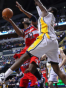 March 29, 2012; Indianapolis, IN, USA; Washington Wizards center Nene (42) shoots the ball against Indiana Pacers center Roy Hibbert (55) at Bankers Life Fieldhouse. Mandatory credit: Michael Hickey-US PRESSWIRE