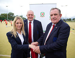 CARDIFF, WALES - Tuesday, August 21, 2014: Trisha Turner makes the draw for the Women's Welsh Cup with FAW President Trefor Lloyd-Hughes [C] and Vice=President Dai Alun Jones at the first Live Your Goals festival in Cardiff. (Pic by David Rawcliffe/Propaganda)