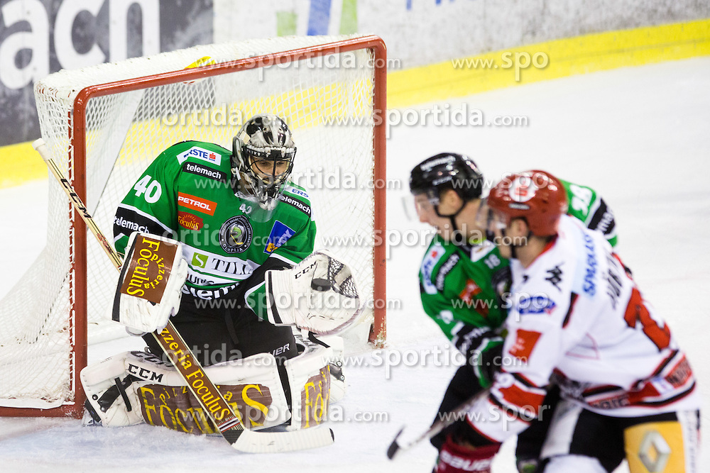 28.09.2014, Hala Tivoli, Ljubljana, SLO, EBEL, HDD Telemach Olimpija Ljubljana vs HC TWK Innsbruck, 6. Runde, in picture Andy Chiodo (HDD Telemach Olimpija, #40) catches the puck during the Erste Bank Icehockey League 6. Round between HDD Telemach Olimpija Ljubljana and HC TWK Innsbruck at the Hala Tivoli, Ljubljana, Slovenia on 2014/09/28. Photo by Matic Klansek Velej / Sportida