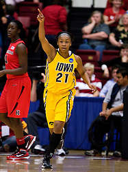 March 20, 2010; Stanford, CA, USA; Iowa Hawkeyes guard Kachine Alexander (21) reacts after making a basket against the Rutgers Scarlet Knights during the first half in the first round of the 2010 NCAA womens basketball tournament at Maples Pavilion. Iowa defeated Rutgers 70-63.