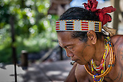 Mentawai indigenous man smoking (Indonesia).