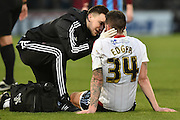 Sheffield United defender, on loan from Birmingham City, David Edgar recieves treatment for head injury  during the Sky Bet League 1 match between Scunthorpe United and Sheffield Utd at Glanford Park, Scunthorpe, England on 19 December 2015. Photo by Ian Lyall.