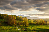 Gorgeous late afternoon light over farm fields during springtime in Waterbury Center, Vermont