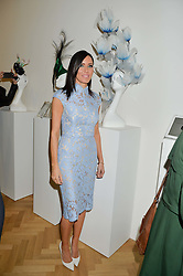 LINZI STOPPARD at a private view and auction of millinery organised by author, philanthropist and hat collector Eva Lanska in aid of Women for Women International held at Pace, Burlington Gardens, London on 10th June 2015.