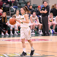 2nd year guard Avery Pearce (4) of the Regina Cougars in action during the home game on December  2 at Centre for Kinesiology, Health and Sport. Credit: Arthur Ward/Arthur Images