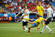 Sweden FW Marcus Berg (11) shoots early on during the Euro 2016 match between Sweden and Belgium at Stade de Nice, Nice, France on 22 June 2016. Photo by Andy Walter.