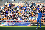 The Oldham fans shade their eyes from the Sun during the EFL Sky Bet League 1 match between Northampton Town and Oldham Athletic at Sixfields Stadium, Northampton, England on 5 May 2018. Picture by Dennis Goodwin.