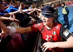 Fans of Krim and Cvijic Dragana of Krim celebrate after the 2nd Round of Group 1 at Women Champions League handball match between RK Krim Mercator, Ljubljana and HC Leipzig, Germany on February 13, 2010 in Arena Kodeljevo, Ljubljana, Slovenia. Krim defeated  Leipzig 32-26. (Photo by Vid Ponikvar / Sportida)