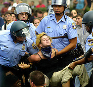 374865 01: (MAGAZINES PLEASE CALL) Philadelphia police officers carry a protester from the street to a police van after she refused to move August 1, 2000 in Philadelphia, on the second day of the Republican National Convention. Protesters committed various acts of civil disobedience, bringing traffic in Center City Philadelphia to a crawl for most of the afternoon. (Photo by William Thomas Cain/Newsmakers)