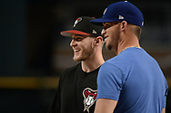 PHOENIX, AZ - AUGUST 10:  Chris Herrmann #10 of the Arizona Diamondbacks smiles alongside Yasmani Grandal #9 of the Los Angeles Dodgers during batting practice for the MLB game at Chase Field on August 10, 2017 in Phoenix, Arizona.  (Photo by Jennifer Stewart/Getty Images)