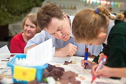 © Licensed to London News Pictures. 01/05/2014. Surbiton, UK. Nick Clegg helps a pupil with maths. Deputy Prime Minister Nick Clegg visits Lime Tree Primary School in Surbiton today 1st May 2014. Whilst there he took part in a painting, phonics and maths projects with school children. Photo credit : Stephen Simpson/LNP
