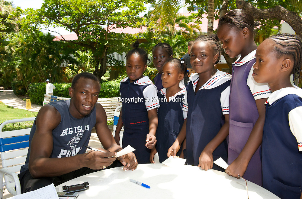 Usain Bolt with schoolgirls in Kongston, Jamaica June'08