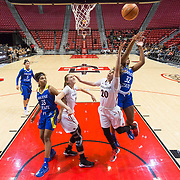 24 February 2018: The San Diego State women's basketball team closes out it's home schedule of the regular season Saturday afternoon against San Jose State. San Diego State Aztecs guard Geena Gomez (20) attempts a layup while being defended by San Jose State Spartans forward Mikaylah Wilson (32) in the second half. The Aztecs beat the Spartans 85-78 at Viejas Arena.<br /> More game action at sdsuaztecphotos.com