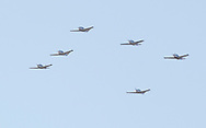 Montgomery, New York -  Six single-engine airplanes fly in formation over Orange County Airport on March 20, 2011.