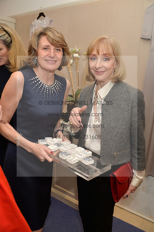 Left to right, KIKI McDONOUGH and LADY ELIZABETH ARNOLD at a preview of the latest collections by jewellery designer Kiki Mcdonough and fashion label Beulah held at Kiki McDonough Jewellery, 12 Symons Street, London on 5th March 2014.