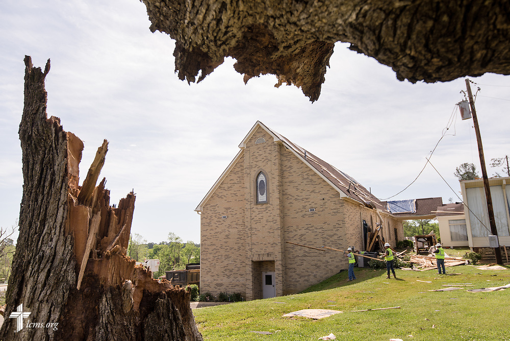Workers remove debris from the grounds of Holy Trinity Lutheran Church in Tupelo, Miss., on Friday, May 2, 2014. A tornado ravaged the community and church earlier in the week. LCMS Communications/Erik M. Lunsford