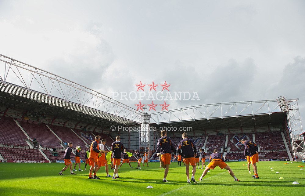 EDINBURGH, SCOTLAND - Wednesday, August 22, 2012: Liverpool players during a training session ahead of the UEFA Europa League Play-Off Round 1st Leg match against Heart of Midlothian at Tynecastle. (Pic by David Rawcliffe/Propaganda)
