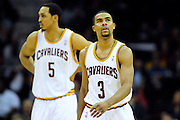 Jan. 28, 2011; Cleveland, OH, USA; Cleveland Cavaliers center Ryan Hollins (5) and point guard Ramon Sessions (3) walk down court during the fourth quarter against the Denver Nuggets at Quicken Loans Arena. The Nuggets beat the Cavaliers 117-103. Mandatory Credit: Jason Miller-US PRESSWIRE