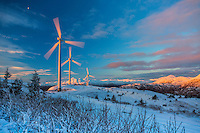 Sunrise light up wind turbines harvesting winter wind near Kodiak, Alaska.