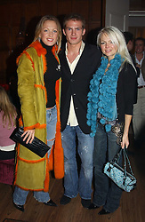 Left to right, MISS EMILY CROMPTON, MR JACOBI ANSTRUTHER-GOUGH-CALTHORPE and MISS HANNAH SANDLING at a party to celebrate the 4th anniversary of Quintessentially held at 11 Grosvenor Place, London  SW1 on 14th December 2004.<br />