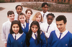 Multiracial group of secondary school pupils wearing uniform,