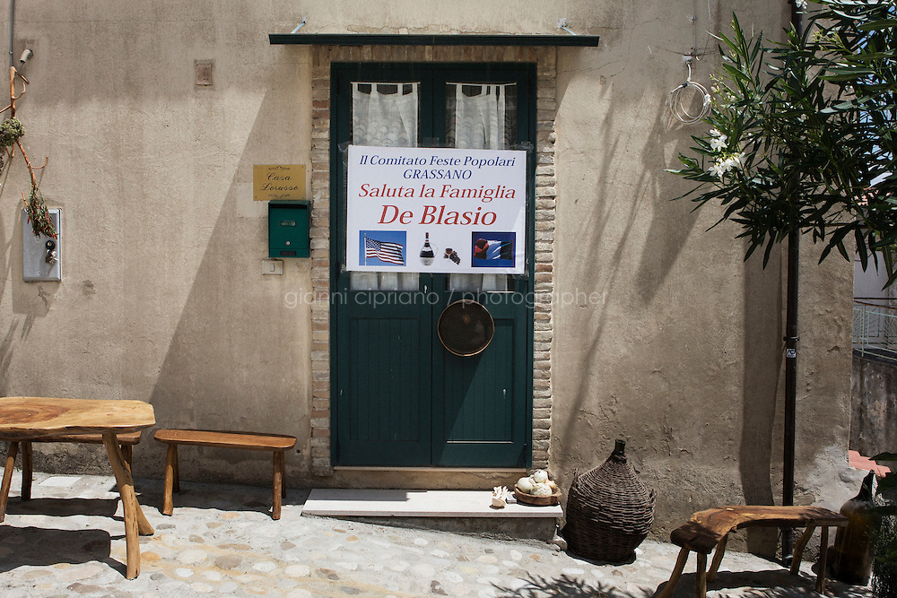 GRASSANO, ITALY - 24 JULY 2014: A welcome sign for Mayor of New York Bill de Blasio is placed in &quot;a chiarazzodda&quot;, the oldest square of Grassano, the ancestral home town of Mayor of New York Bill de Blasio in Italy, on July 24th 2014.<br /> <br /> New York City Mayor Bill de Blasio arrived in Italy with his family Sunday morning for an 8-day summer vacation that includes meetings with government officials and sightseeing in his ancestral homeland.