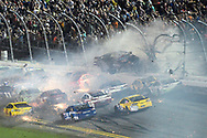 Austin Dillon (3) crashes into the fence on the final lap during a NASCAR Sprint Cup series auto race at Daytona International Speedway in Daytona Beach, Fla., Monday, July 6, 2015. (AP Photo/Phelan M. Ebenhack)