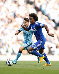 Willian of Chelsea is challenged by David Silva of Manchester City - Photo mandatory by-line: Rogan Thomson/JMP - 07966 386802 - 21/08/2014 - SPORT - FOOTBALL - Manchester, England - Etihad Stadium - Manchester City v Chelsea FC - Barclays Premier League.
