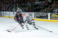 KELOWNA, CANADA - MARCH 26: Dallas Valentine #6 of Kamloops Blazers back checks Rourke Chartier #14 of Kelowna Rockets as he skates with the puck during first period on March 26, 2016 at Prospera Place in Kelowna, British Columbia, Canada.  (Photo by Marissa Baecker/Shoot the Breeze)  *** Local Caption *** Dallas Valentine; Rourke Chartier;