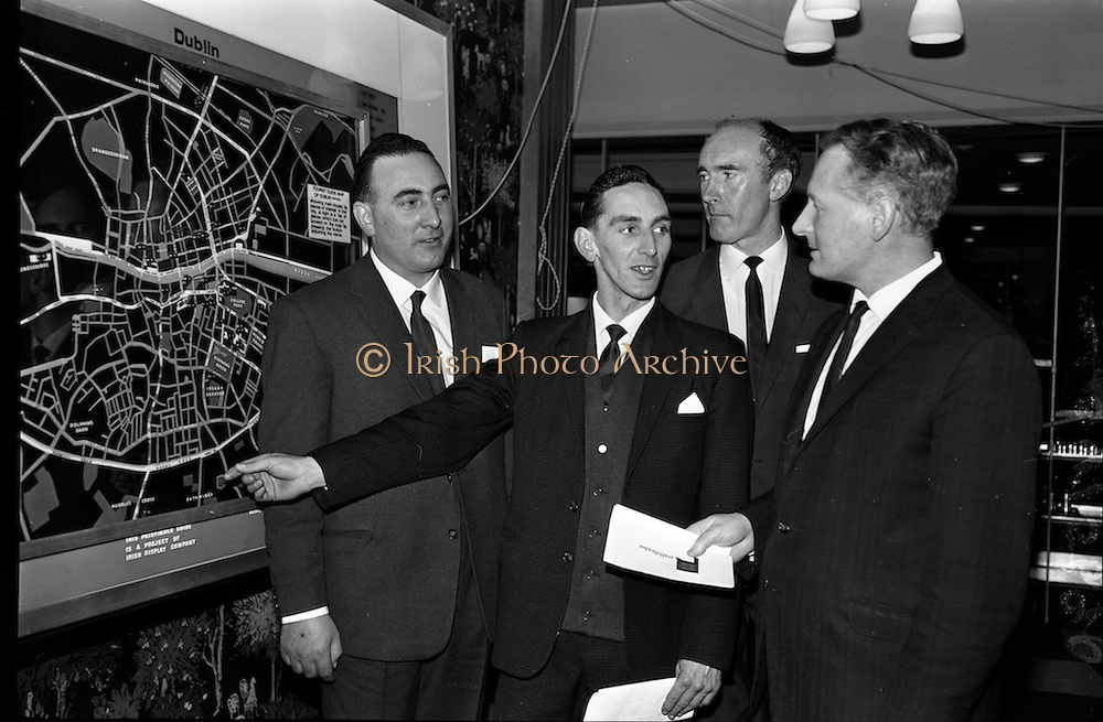 11/11/1964<br /> 11 November 1964<br /> <br /> Mr Sean O'Brien and Mr George Sisson both men directors for Irish Display Company showing the display to Mr John Doody the Retail Sales Manager at Arnotts and Mr Tim Dennehy of C.I.E