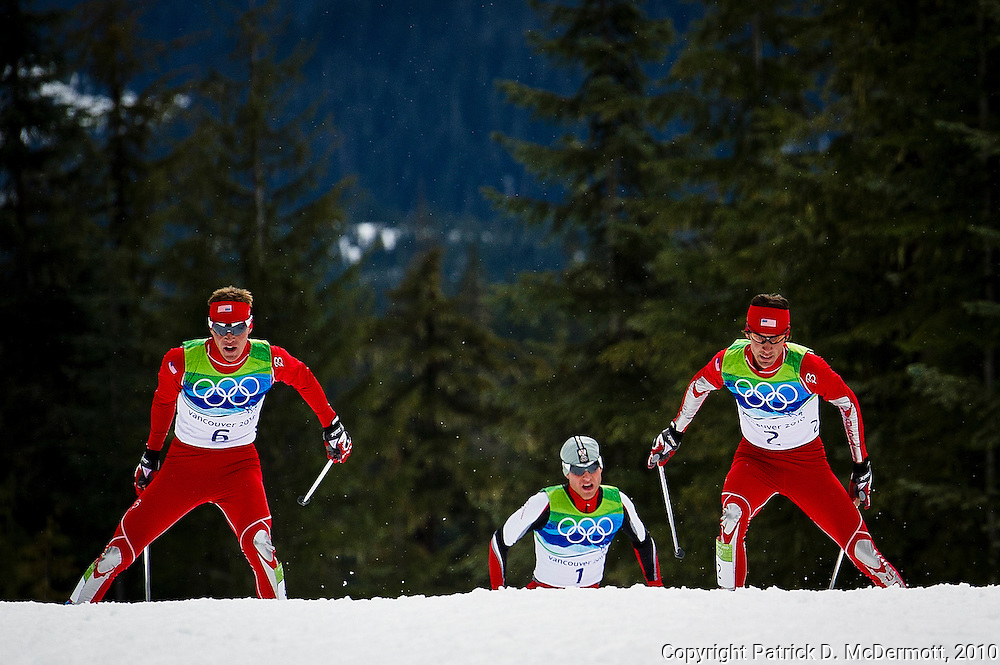 Johnny Spillane, USA, leads Bill Demong, USA and Bernard Gruber, AUT, during the Men's Individual Nordic Combined Large Hill/10km race during the 2010 Vancouver Winter Olympics in Whistler, British Columbia, Thursday, Feb. 25, 2010. Demong won the first gold medal for the USA in a Nordic Combined competition.