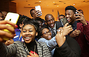 "Students take selfies with Earvin ""Magic"" Johnson before he speaks at E. C. Central High School in East Chicago."