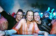 Nederland, Nijmegen, 20-5-2006<br /> Op het recreatieterrein de Berendonck bij Nijmegen speelde zich zaterdag tussen 14.00 en 12.00 uur het Dance festival Emporium af. Door wind en regen zien de 20.000 jonge bezoekers het terrein al snel veranderen in een modderpoel. Verspreid over twee openluchtpodia en drie grote tenten weten tientallen dj's de bezoekers te vermaken. Het slechte weer zorgde echter toch voor een andere sfeer als de organisatoren gehoopt hadden<br /> Foto: Flip Franssen