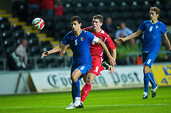 SWANSEA, ENGLAND - Friday, September 4, 2009: Wales' Sam Vokes and Italy's Andrea Ranocchia during the UEFA Under 21 Championship Qualifying Group 3 match at the Liberty Stadium. (Photo by David Rawcliffe/Propaganda)