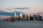 A Staten Island Ferry sails away from the famous skyscraper skyline of Downtown Manhattan at sunset photographed from Upper Bay, New York City, New York United States of America. <br />  (photo by Andrew Aitchison / In pictures via Getty Images)