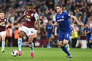 Aston Villa striker Wesley (9) controls under pressure from Everton defender Michael Keane (5) during the Premier League match between Aston Villa and Everton at Villa Park, Birmingham, England on 23 August 2019.