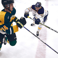 1st year forward, Tate Coughlin (14) of the Regina Cougars during the Men's Hockey Home Game on Sat Oct 13 at Co-operators Center. Credit: Arthur Ward/Arthur Images